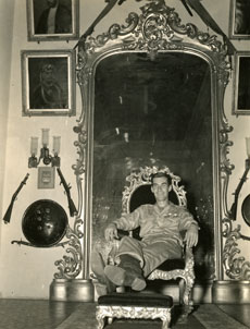 [An American G.T. Pretends to be a Maharajah in the Dignitary's Chair]