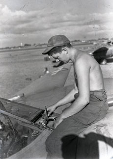 [A Mechanic Working on an Engine]