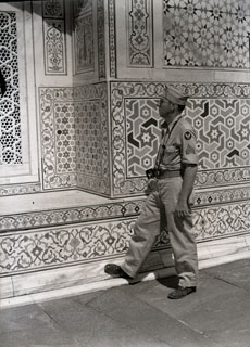 [The Photographer Inspects Taj Mahal Stone Work]