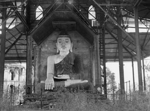 [A Large Buddha in a War-Damaged Shrine]