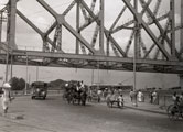 [Under the Howrah Bridge]