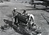 [The Mechanics Working on an Engine]