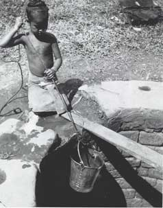 [Youngster fetching water]