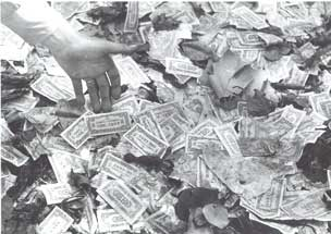 [Paper money litters the streets]
